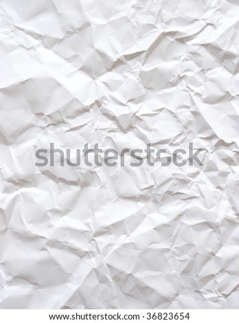 A piece of plain white bond paper that has been wrinkled. - stock photo