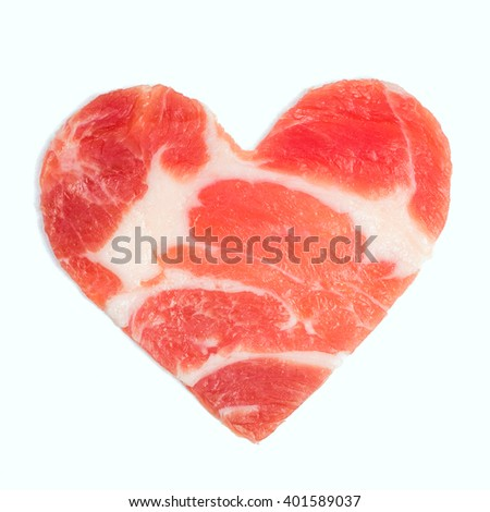 A piece of raw meat in the form of heart. Isolated - stock photo
