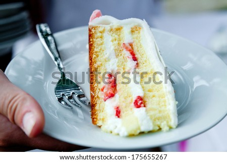 a piece of wedding cake - stock photo