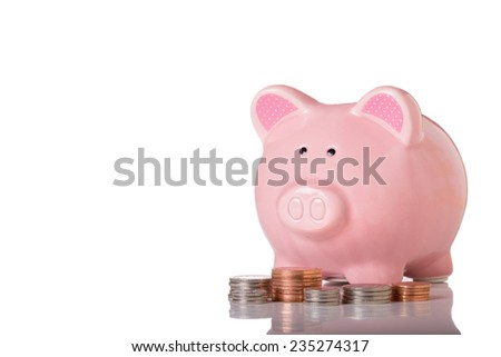A Piggy Bank and Coin Stacks Isolated on a White Background.Copy Space. - stock photo