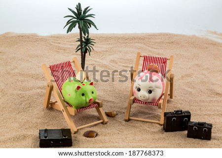 a piggy bank is located in a deck chair. symbolic photo for travel and low cost vacation - stock photo