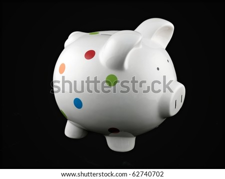 A piggy bank isolated against a black background - stock photo