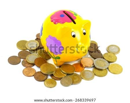 A piggy bank or a money box with euro coins over white - stock photo