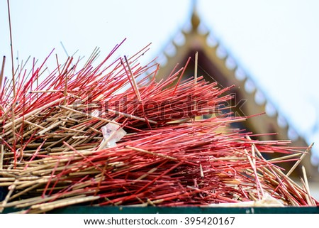 A pile garbage with incense in thai temple,cause global - stock photo
