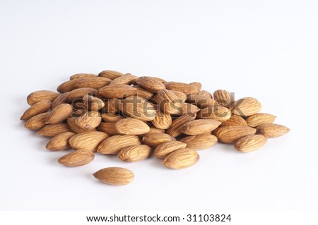 A pile of almonds  on white background - stock photo