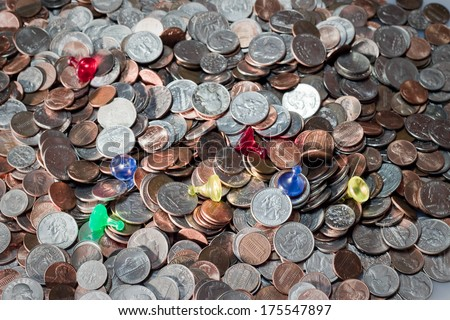 A pile of American coins and tokens representing success and failure - stock photo