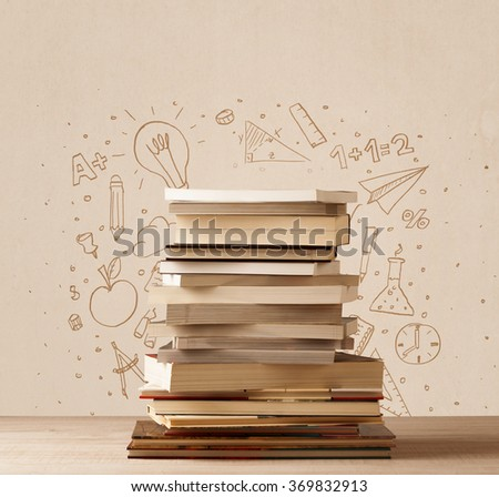 A pile of books on table with school hand drawn doodle sketches and symbols - stock photo
