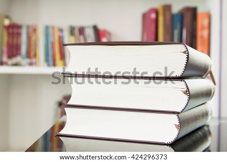 A pile of books with library. - stock photo