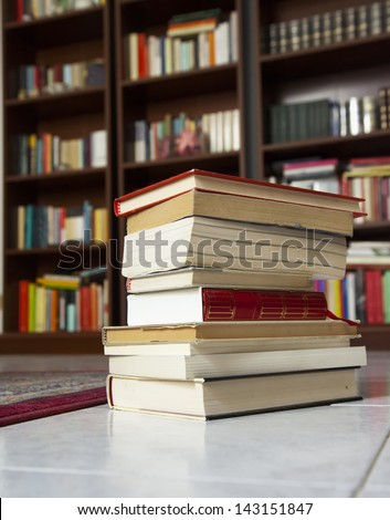 A pile of books with library on the back - stock photo