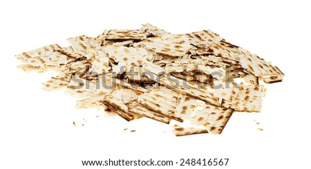 A pile of broken pieces of Jewish Matzah bread, the substitute for bread on the Jewish Passover holiday, isolated on white background. - stock photo