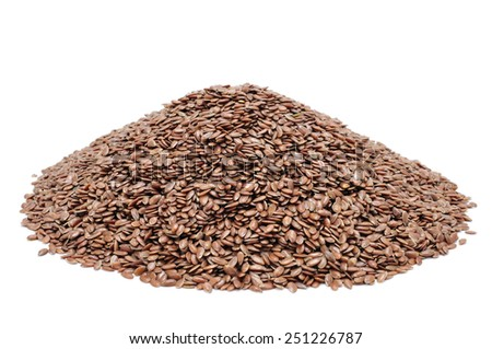 a pile of brown flax seeds on a white background - stock photo
