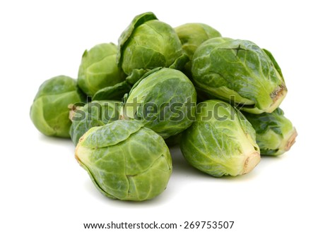 a pile of brussel sprouts on white background  - stock photo