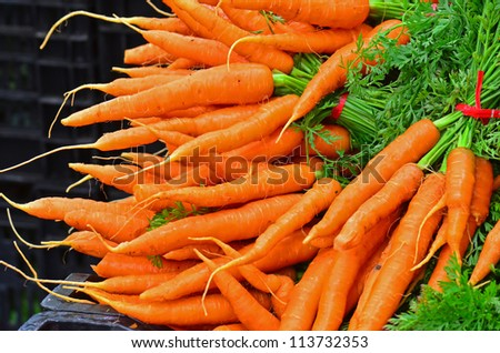 A pile of carrots for sale at a local farmers market. - stock photo