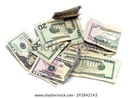 A pile of cash, American dollars in twenties and fifties on white, not isolated. - stock photo