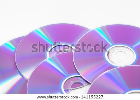 A pile of CDS ready to be written to. - stock photo