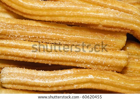 a pile of churros, a typical Spanish sweet - stock photo