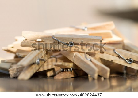 A pile of clothespins. - stock photo