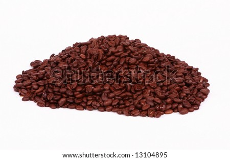 A pile of colombian roasted coffee beans shot on a white background. - stock photo