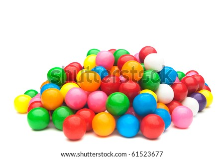 A pile of colorful gumballs on a white background. - stock photo