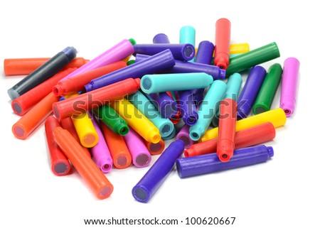 A pile of colour fountain pen refill cartridges - stock photo