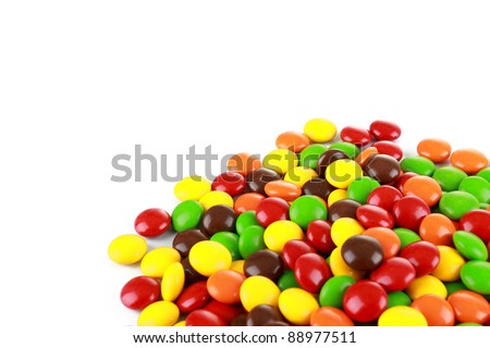 a pile of colourful candies isolated over white background - stock photo