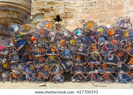 A pile of crab traps in the old port of Essaouira - stock photo