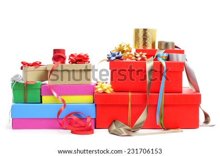a pile of different boxes, ribbon and ribbon bows of different colors to prepare gifts, on a white background - stock photo