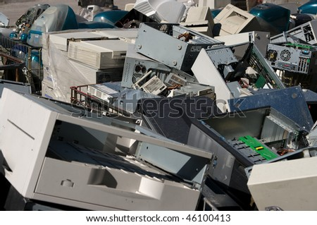 A pile of dismantled computer parts for electronic recycling - stock photo