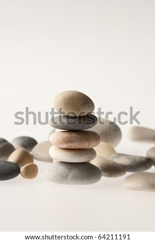 A pile of eight stones balancing on top of each other - stock photo