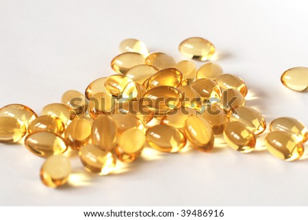 A pile of fish oil capsules - stock photo