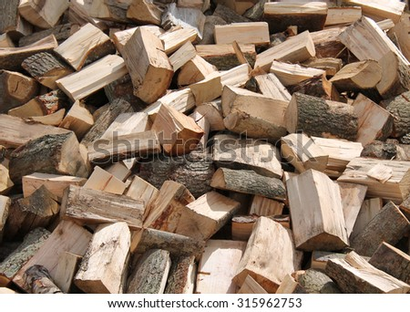A Pile of Freshly Cut Firewood Logs. - stock photo