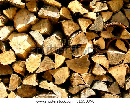 A Pile of freshly split pieces of firewood. - stock photo