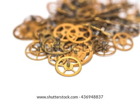A pile of gear. Many mechanisms. Old vintage gears. Part of clockwork. The natural color and texture. Focus on front, blurred background. - stock photo