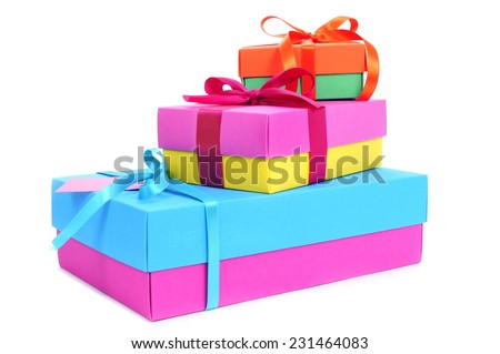 a pile of gift boxes of different sizes and colors tied with satin ribbon on a white background - stock photo