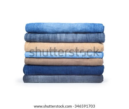 A pile of jeans on a white background - stock photo