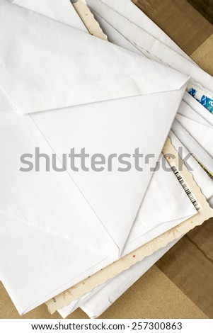 a pile of letters and postal parcel - stock photo