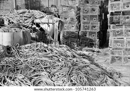 A pile of lobster pots on the quay in a small fishing village. - stock photo