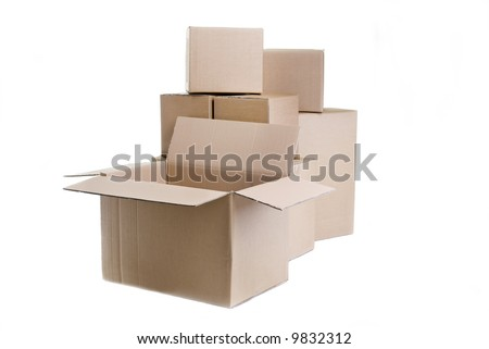 A pile of moving boxes with one open and ready to fill. - stock photo