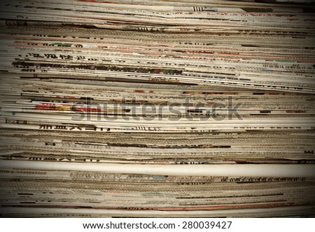 A pile of old newspapers - stock photo