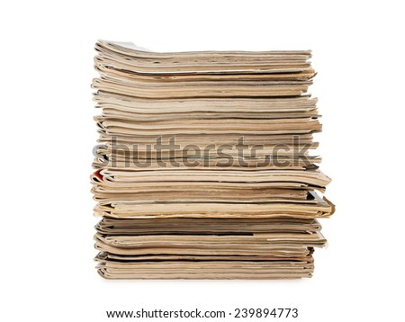 a pile of old yellow magazines isolated on white background, studio shot - stock photo