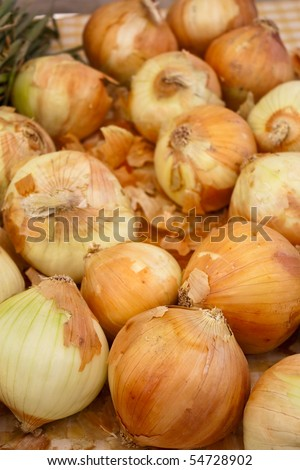 A pile of organic onions at the local farmers market - stock photo