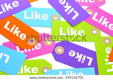 a pile of paper labels of different colors with the word like written on them - stock photo