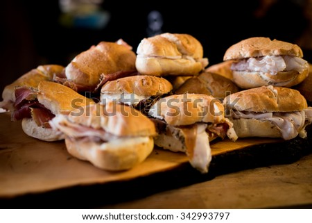 A pile of prepared sandwiches and rolls. - stock photo