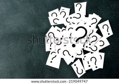 A pile of question marks - stock photo