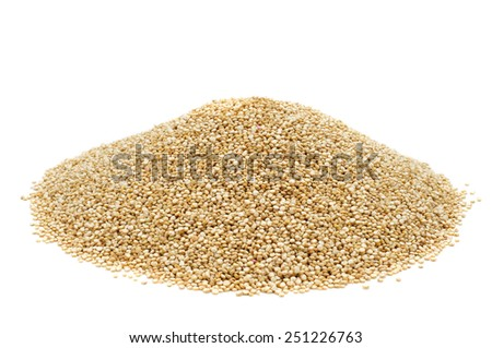 a pile of quinoa seeds on a white background - stock photo