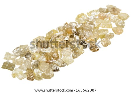 A pile of raw, uncut natural diamonds on white - stock photo