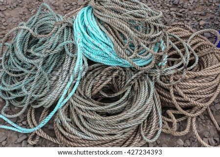 A pile of rope used on a fishing boat - stock photo