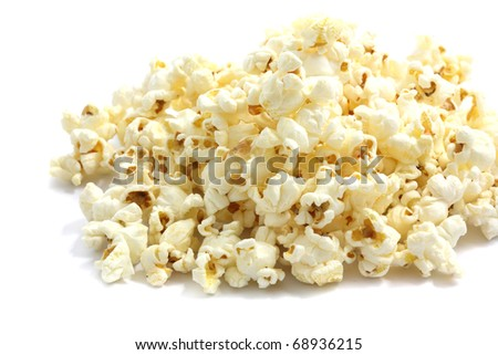 A pile of salted popcorn isolated on white background. - stock photo