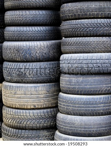 A pile of some old tires - stock photo