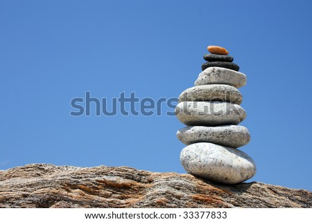 a pile of stones on a rock - stock photo